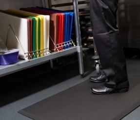 Worker standing on a rubber mat